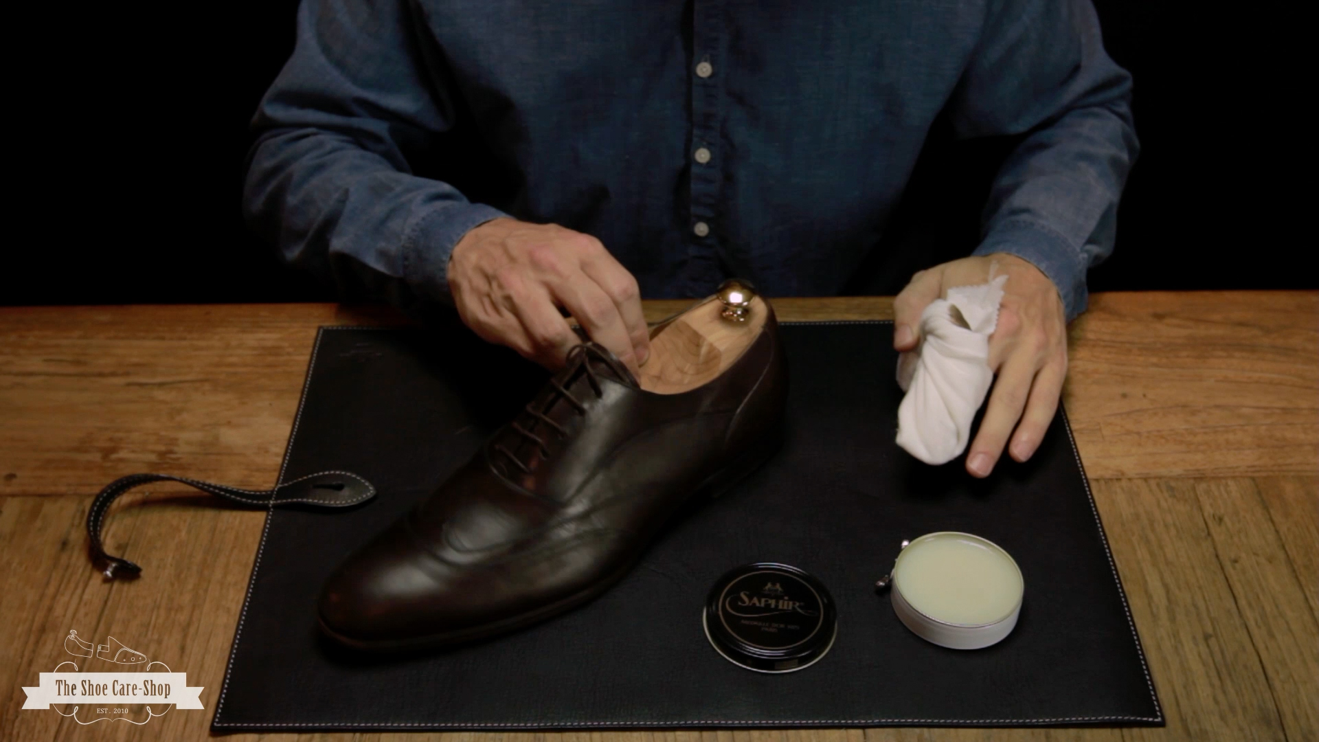 Use a soft cloth or a brush to remove any grime that may be stuck to the shoe's leather surfaces. Step 3: Apply soap. Mix a solution of warm water and dish soap, dip a soft cloth into it, wring it out and wipe the exterior surfaces of the shoe.